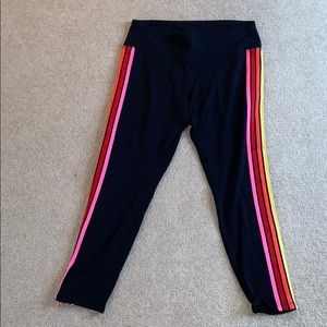 black leggings with colorful stripes on the sides